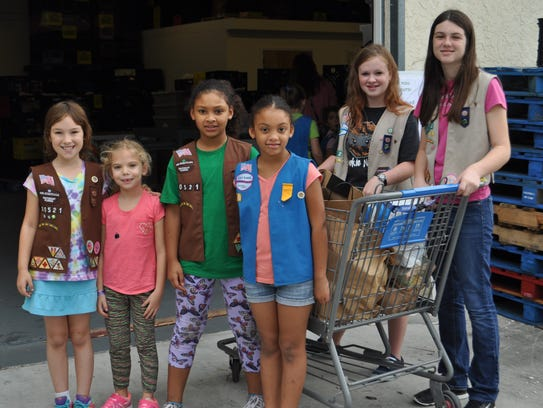 Martin County Girl Scout troops 30521 and 30072 work