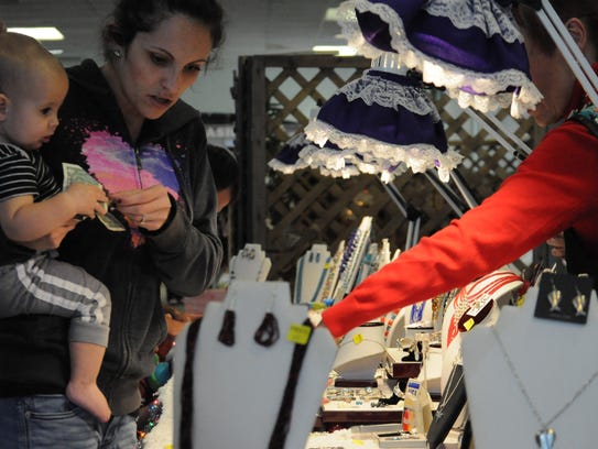 Attendees sample and inspect hundreds of homemade products