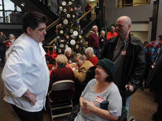 Chef James Clary visiting with two guests during the