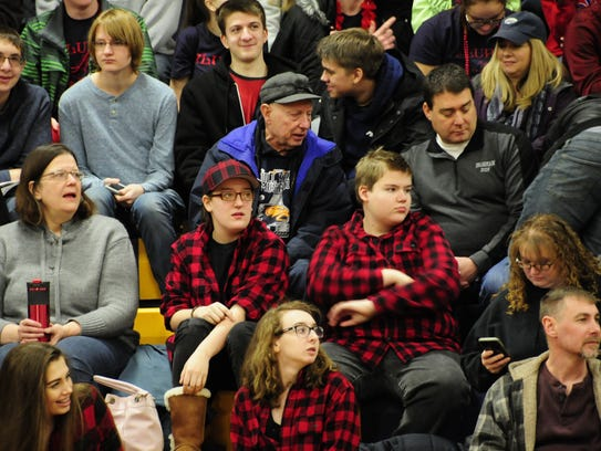 Students and parents wait for the FIRST Robotics reveal