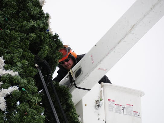 City worker Ryan Johnson removes one of the panels