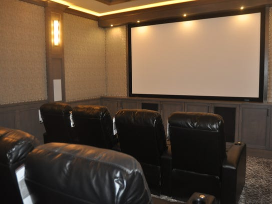 A movie theater with eight seats is featured in this