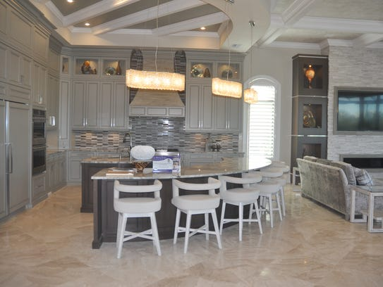 This open concept plan includes a family room, kitchen,