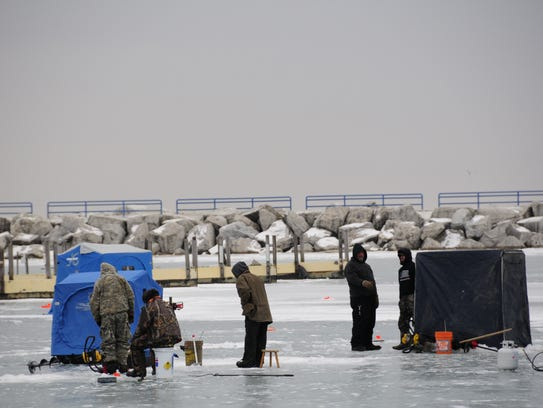 Anglers gather on the ice of Lexington Harbor during