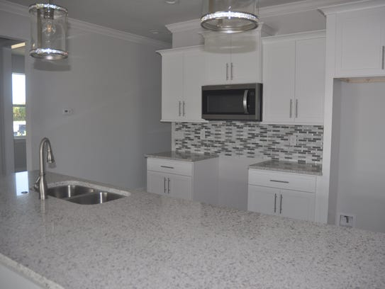 The kitchen has a long wide countertop island that
