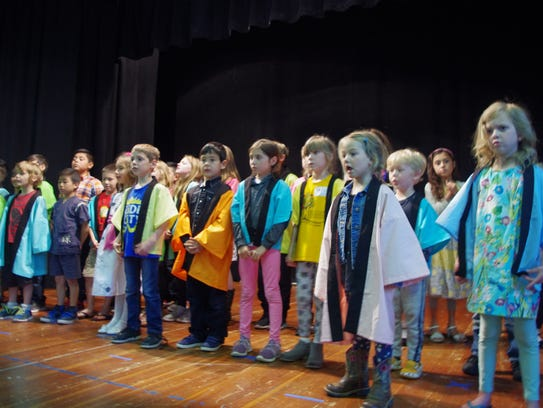 Children sing a traditional Japanese song Sunday during