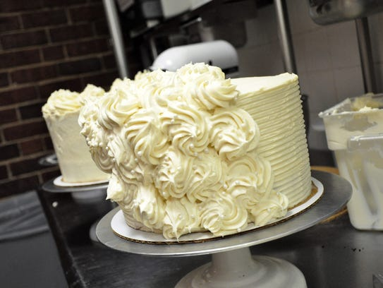 A cream cheese frosting adorns a red velvet cake at the Texas State Technical College Culinary Institute on Thursday. The cakes plus many other desserts will be sold at the TSTC Culinary Arts Bake Sale.
