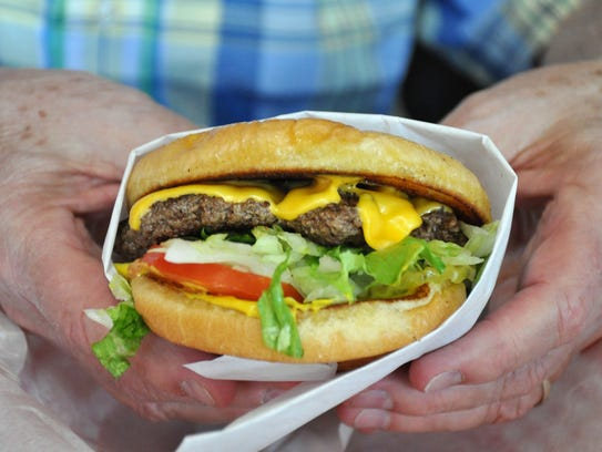 A cheeseburger at Gloria's Grill includes all the fixings and a toasted bun.