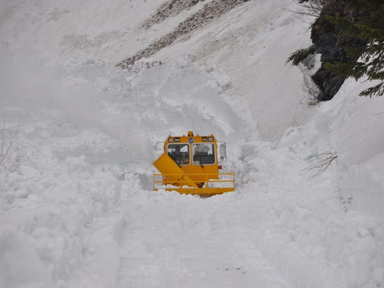 Plows work on the Going to the Sun Road In Glacier