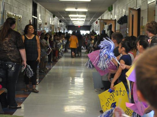 Students at Joe Stanley Smith Elementary School cheered
