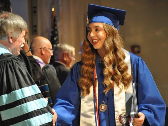 ECHS graduate Myreah Lozano receives her diploma at