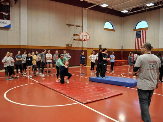 "Martial arts instructor Michael Elayan, at right, shows Ridgewood High School students how to break away from an assailant during ""Be Prepared!"" The Saturday workshop was aimed at teaching college-bound women self defense methods to prevent sexual assault."