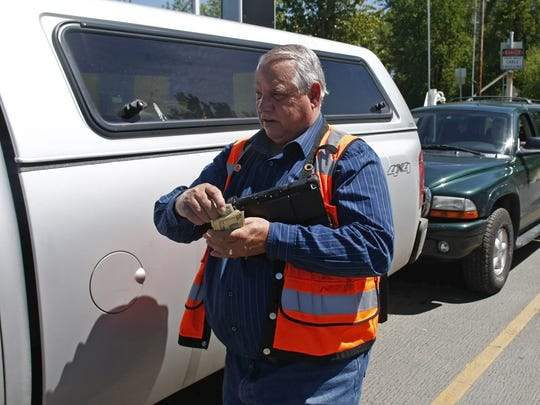 Ed Watson, a senior ferry operator with Marion County Public Works, collects fares on the Wheatland Ferry on Wednesday, Apr. 30, 2014. Watson has been operating the Wheatland and Buena Vista ferries for nearly 20 years.