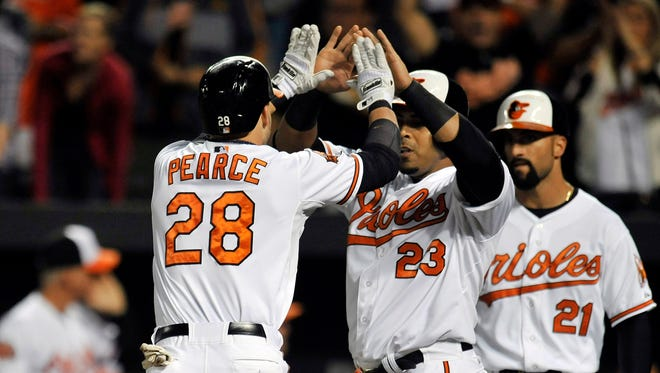 Steve Pearce celebrates his three-run home run with Nelson Cruz.