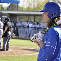 Rogers' Harrison Heffley waits on deck during a game against Fayetteville at Veteran's Park in Rogers. Heffley, who has signed to play baseball at Arkansas next season in college, is one of a shrinking number of high school athletes who have chosen to play multiple sports as opposed to specializing.