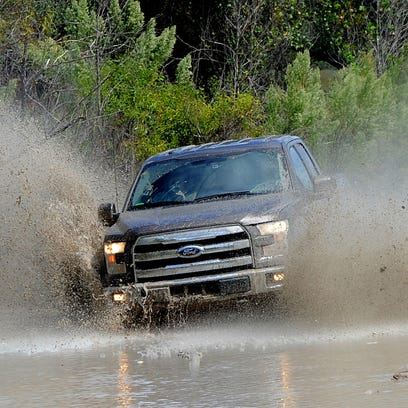 Ford's aluminum-body, 2015 F-150 being tested in Texas September, 2014. Ford has to draw buyers to the new design to keep profits healthy.