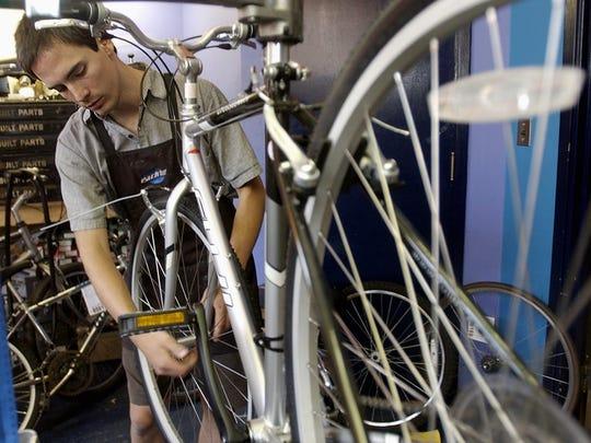 Park Hills resident Jason Reser works on a bike at