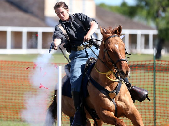 Autumn Ehler shoots a balloon during the Regional Cavalry Competition at Fort Concho National Historic Landmark in 2016.