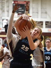 Hardin Valley's Abbey Cornelius (25) grabs a rebound against Bearden during a high school basketball game at Bearden High School in Knoxville on Monday, Feb. 29, 2016.