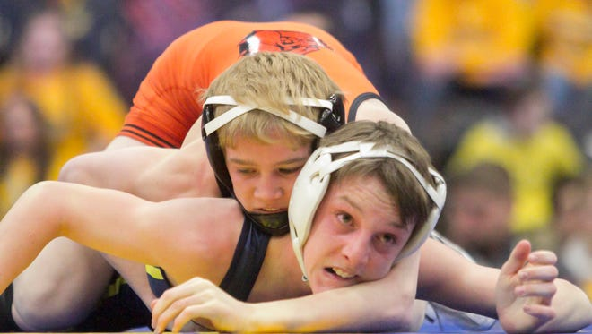 Mason Shrader (top), sixth in the state at 103 pounds last year, is one of nine all-staters Brighton can put in its wrestling lineup.