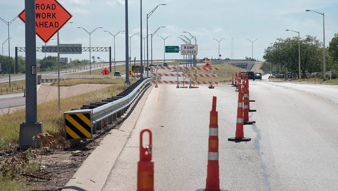 The west-bound entrance ramp to Houston-Harte Expressway from the Dallas access road, just before the Garfield overpass, is temporarily closed to motorists.