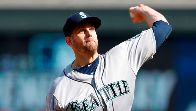 Seattle Mariners pitcher James Paxton throws against the Minnesota Twins in the first inning of a baseball game Thursday in Minneapolis.