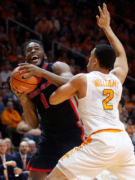 Georgia forward Yante Maten (1) is defended under the basket by Tennessee forward Grant Williams (2) during the first half of an NCAA college basketball game Saturday, March 3, 2018, in Knoxville, Tenn. (AP Photo/Crystal LoGiudice)