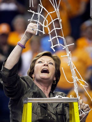 Pat Summitt found herself in the position of cutting down a net dozens of times during her coaching career.