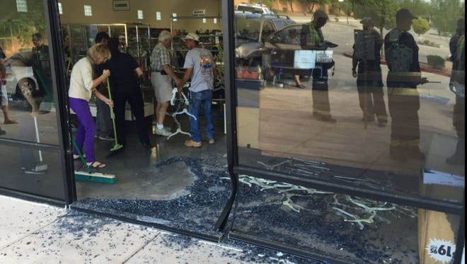 Officials say no one was hurt when a car crashed into the Desert Thrift Shop at Main Street and Greenfield Road in Mesa.