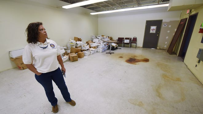 Stains cover the floor in the south Jackson building where there Hinds County coroner's office is located. Coroner Sharon Grisham-Stewart, left, says she and her staff must contend with multiple leaks on rainy days as well as other issues.