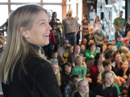 Dava Newman visits with grade school children