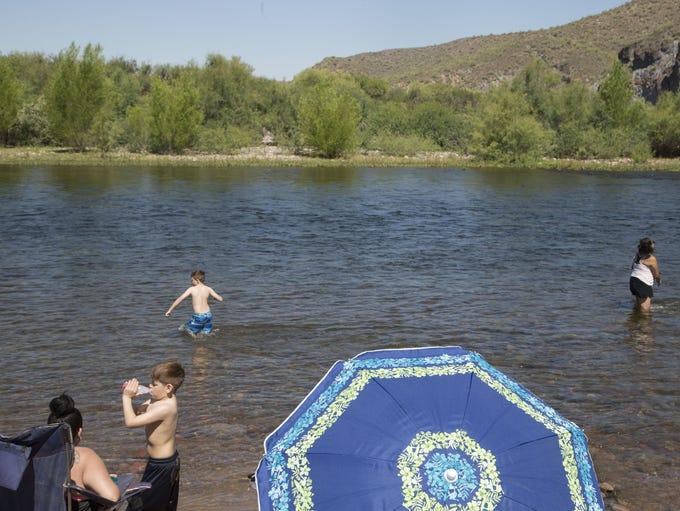 Tubers make their way down the Salt River enjoying