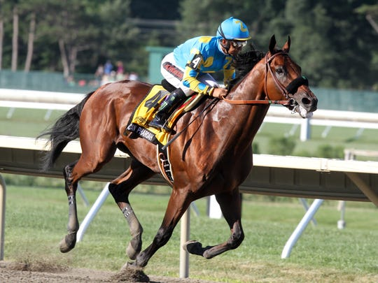 American Pharoah wins the 2015 William Hill Haskell Invitational at Monmouth Park.