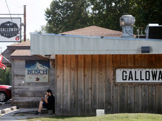 Miles Brent, a cook at Galloway Grill, sits outside