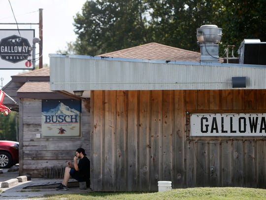 Miles Brent, a cook at Galloway Grill, sits outside while on break on Tuesday, August 30, 2016.