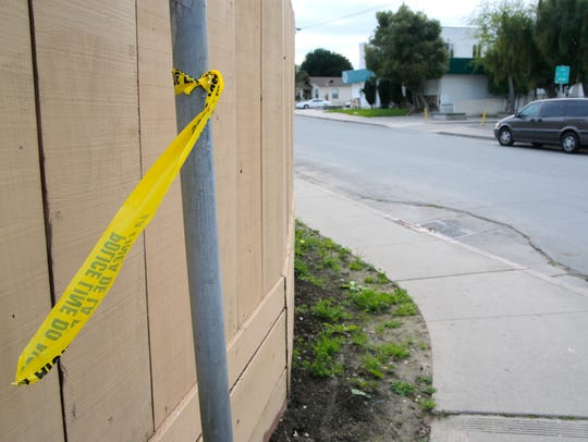 Police tape remains at the corner of North Hebbron