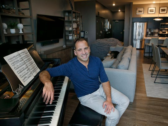 Brandon Comella in his two bedroom apartment at Tower280 in downtown Rochester.