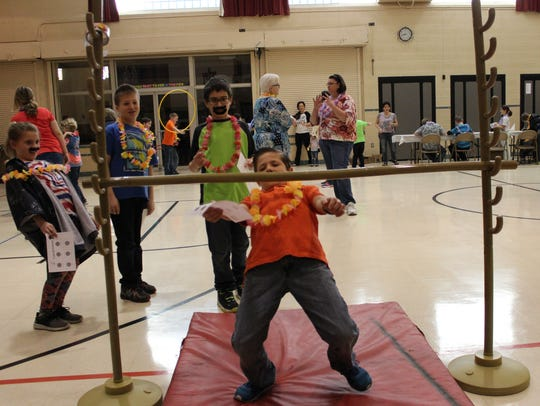 Students participated in coconut bowling, pineapple