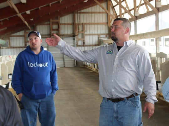 Dairy Operations Manager J.J. Pagel (right) and calf manager Shawn Miller discuss ventilation and air flow inside one of many calf barns at Pagel's Ponderosa Calf Ranch in Kewaunee.