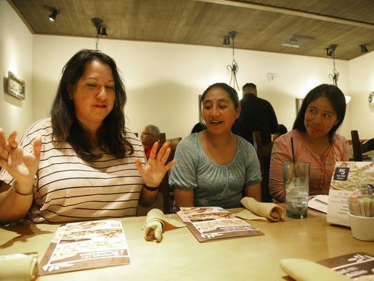 Kendra Harrison (left to right) talks with Juana Soch-tohom