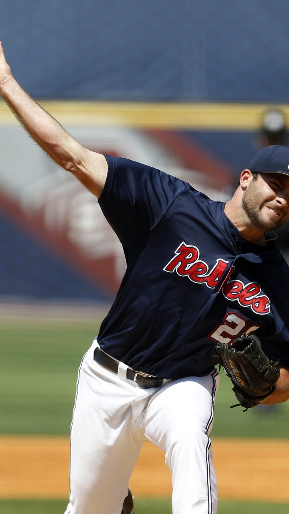 Mississippi's Sam Smith pitches against Arkansas during the first inning at the Southeastern Conference NCAA college baseball tournament Friday, May 23, 2014, in Hoover, Ala. (AP Photo/Butch Dill)