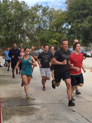 Athletes at Ragin' CrossFit participate in WOD with Warriors on Saturday.