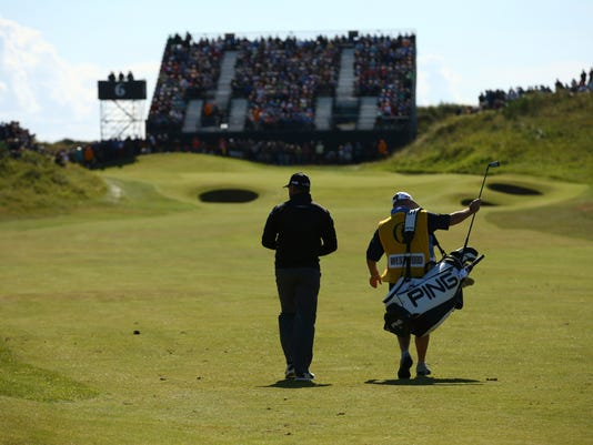 England's Lee Westwood and his caddie Bill Foster walks along the 6th fairway during the first round of the British Open Golf Championship, at Royal Birkdale, Southport, England Thursday, July 20, 2017. (AP Photo/Dave Thompson)