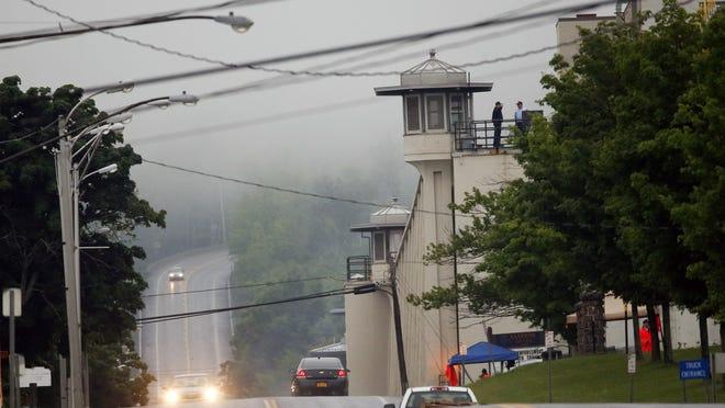 Vehicles drive past Clinton Correctional Facility in Dannemora on Monday. Gov. Andrew Cuomo