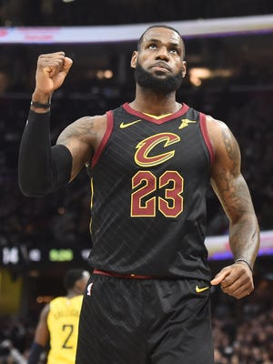 Cleveland Cavaliers forward LeBron James (23) reacts after a basket during the first half against the Indiana Pacers in game seven of the first round of the 2018 NBA Playoffs at Quicken Loans Arena.