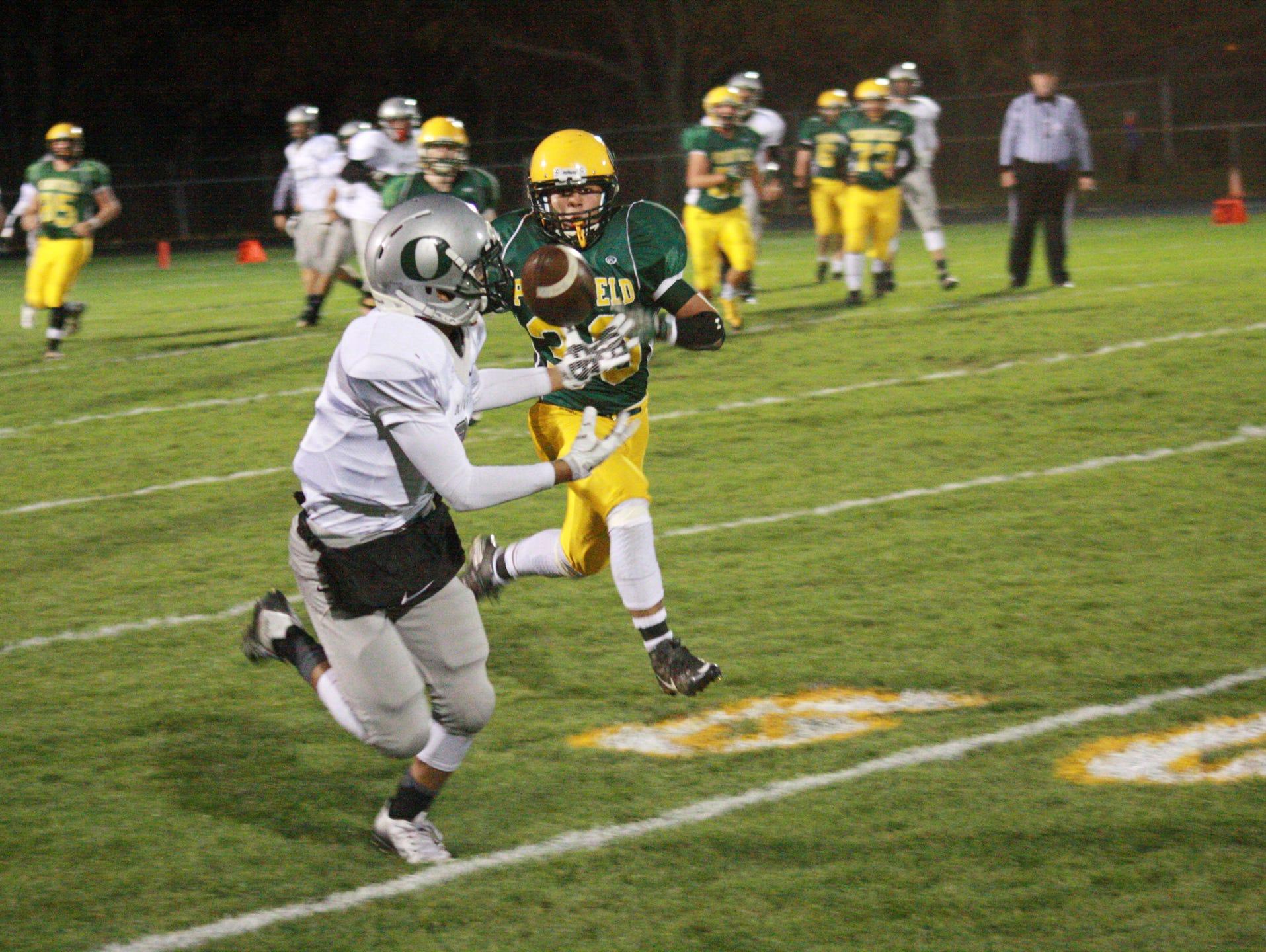 Olivet High Schol Junior Freddy Fuentes misses a catch against Pennfield High School Friday night