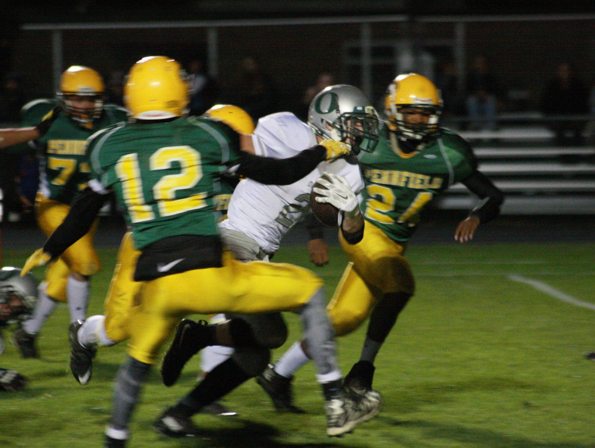 Olivet High School Senior, Wyatt Smith runs against Pennfield during Friday night's game