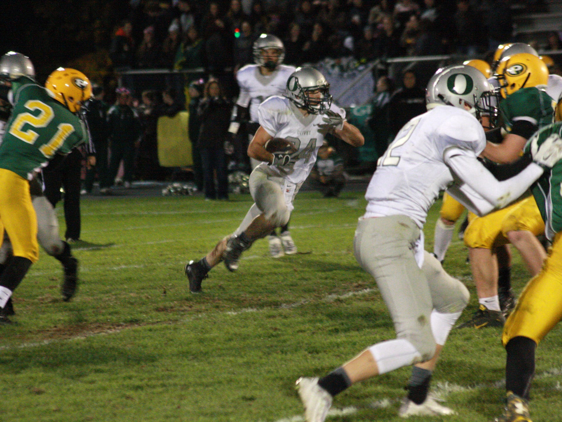 Olivet High School Senior, Chase Martin makes a run during Friday night's game at Pennfield High School