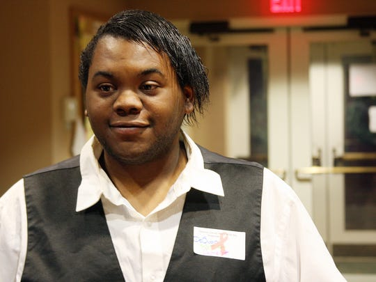 DeQuan Perry sang at the Calhoun County World AIDS Day Observance that was held in tribute to Aric Schramm at First Congregational Church Tuesday evening.