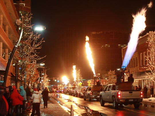 Hot air balloon burners are fired up during the 2015 Battle Creek Christmas Parade.